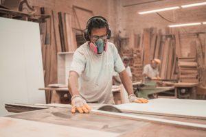 men working on wood materials